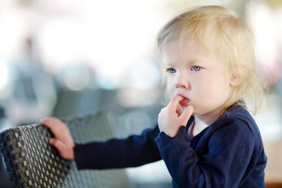 Cute little girl sucking her finger